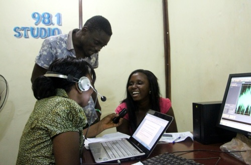Keziah Gbondo, Arnold Elba and Mabel Kabba share a laugh on a conference call.
