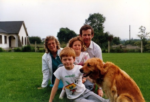 "Me, my family, and our friends' dog ""Auburn"", circa 1987."