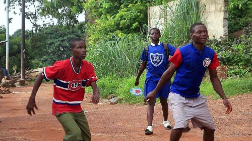 Ajayi Decker in his Habs jersey. Soccer in the only game in Freetown, but North American sports shirts are popular.