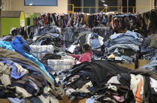 An employee sorts clothing at DYN Exports